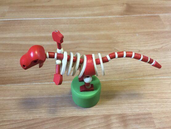 Dřevěná mačkací figurka –  Dinosaurus