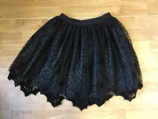 Kostýmová sukně H&M, vzor pavučina